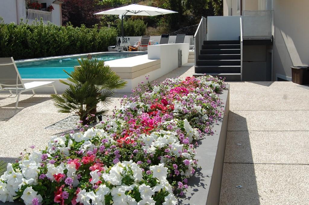 hotel-nettuno-cala-gonone_slider-giardino-piscina-2